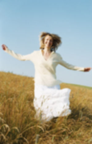 Woman running outdoors smiling.jpg