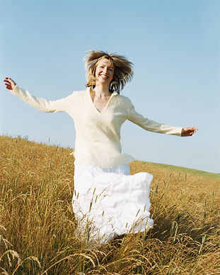 Woman running outdoors smiling.jpg