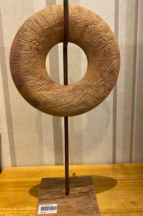 Wooden ring on stand