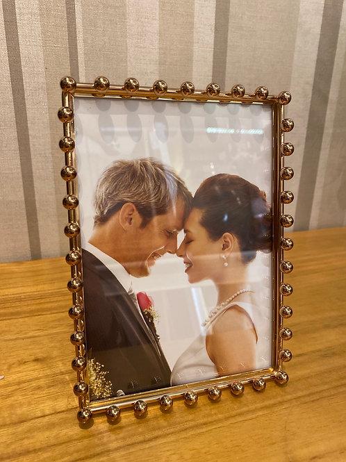 Gold beaded photo frame