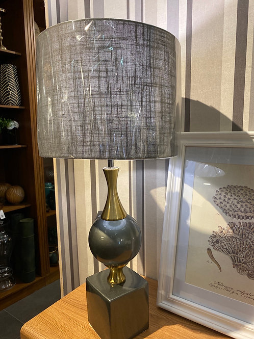 Grey and brass lamp
