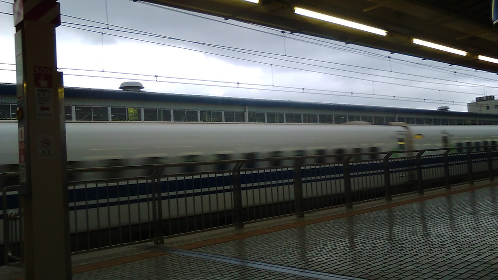 Shinkansen (super rapid train) passing Mishima Station