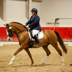 Susan Peacock competing on chestnut horse at dressage event