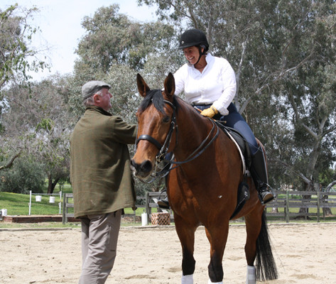 Susan Peacock training on bay horse