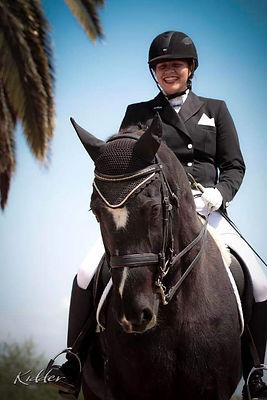 Jamie Volaski Riding Dark Bay Horse