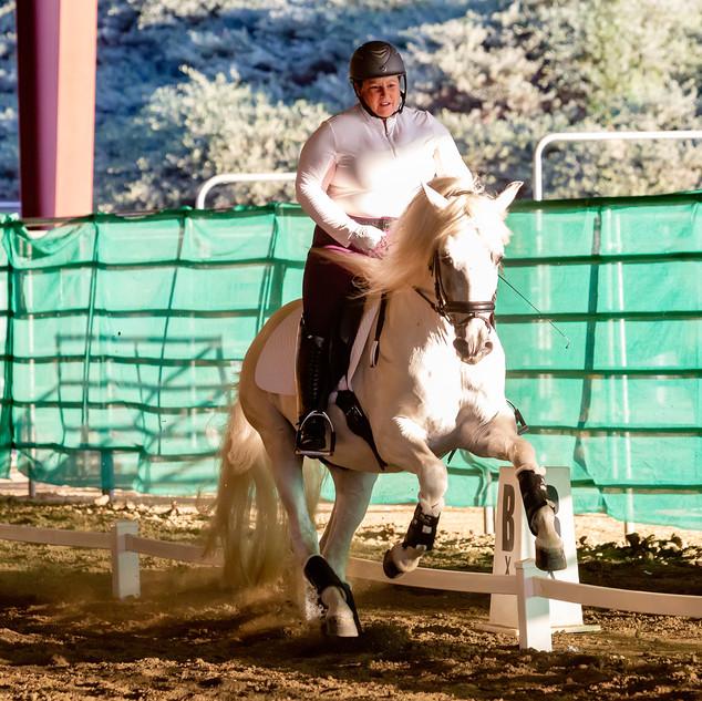Susan Riding Galloping White Horse