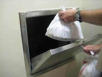Placing-trash-bag-inside-trash-chute