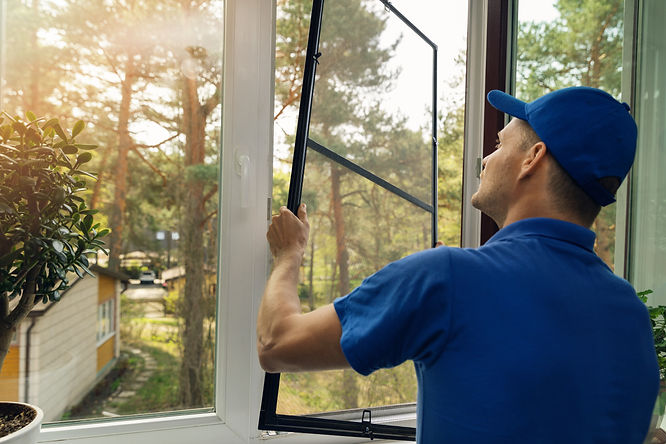 paramount-pest-management-worker-inspecting-window-screen