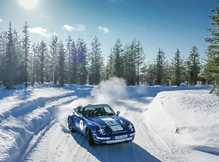 sliding blue porsche 911 on ice
