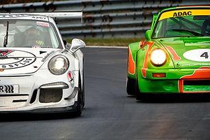 two porsche 924 racing on a circuit
