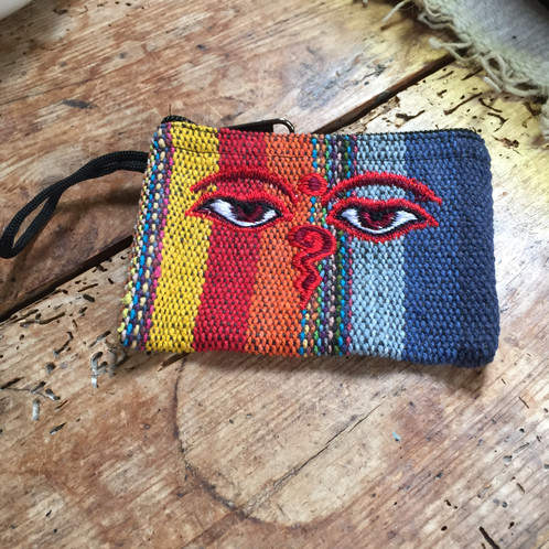 fd9407e79 This super cool cotton purse is made from gheri material and is embroidered  with the iconic wisdom eyes (also known as The Buddha eyes) commonly seen  on ...