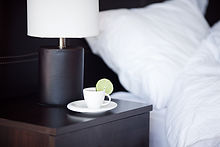 Hotel bedside table with tea