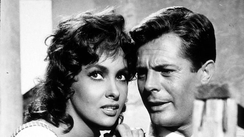 "Gina Lollobrigida and Marcello Mastroianni in 1959's ""The Law."""