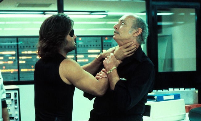 """Kurt Russell threatens Lee Van Cleef in 1981's """"Escape from New York."""""""