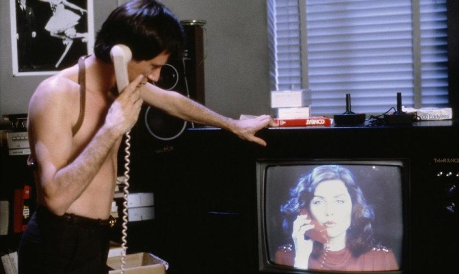 """James Woods and Deborah Harry in 1983's """"Videodrome."""""""