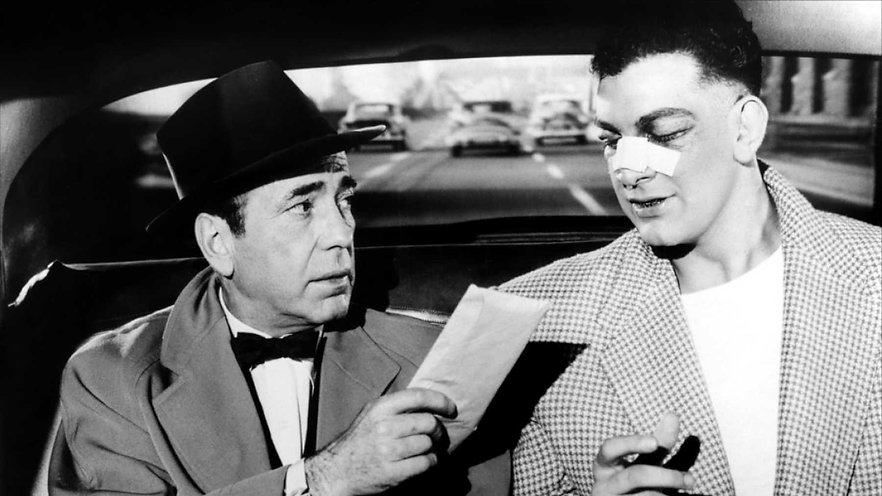 "Humphrey Bogart and Mike Lane in 1956's ""The Harder They Fall."""