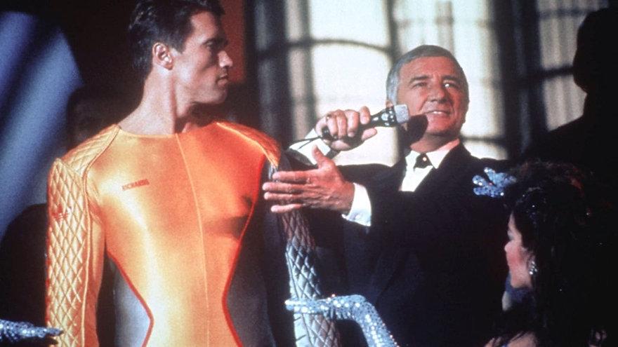 "Arnold Schwarzenegger and Richard Dawson in 1987's ""The Running Man."""