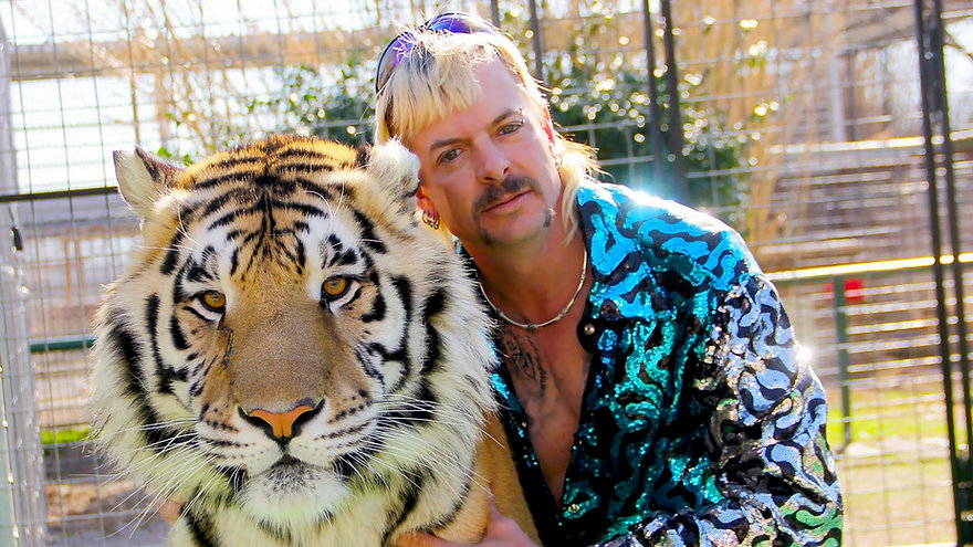 """Joe Exotic and one of his kitties in 2020's """"Tiger King."""""""