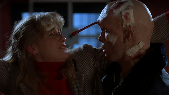 """Barbara Crampton and Jeffrey Combs in 1986's """"From Beyond."""""""