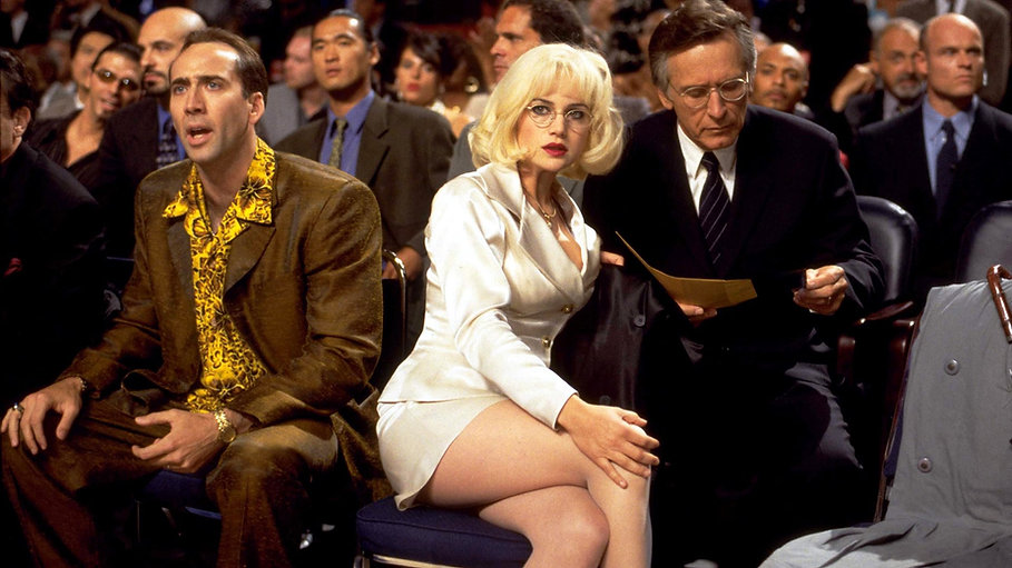 """Nicolas Cage and Carla Gugino in 1998's """"Snake Eyes."""""""