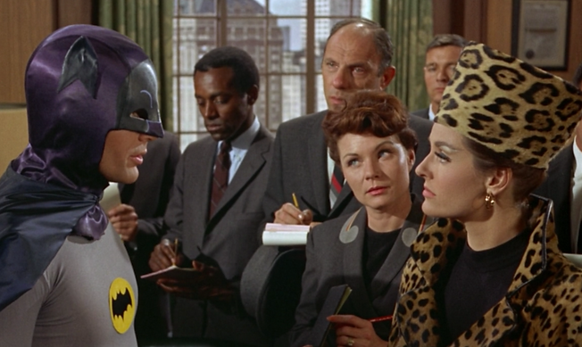 """Batman converses with an incognito Catwoman in 1966's """"Batman: The Movie."""""""