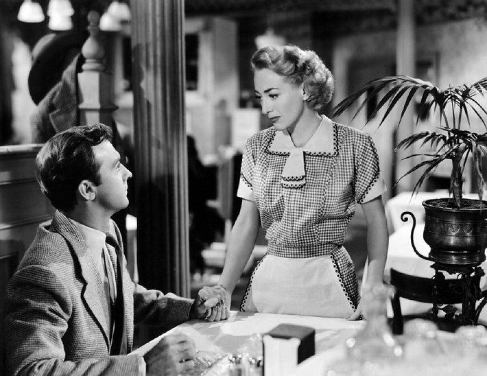 "Zachary Scott and Joan Crawford in 1949's ""Flamingo Road."""