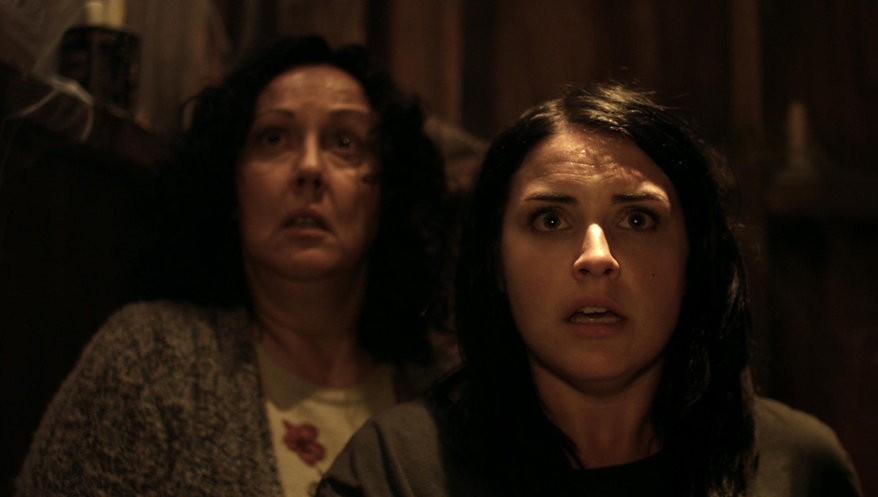 "Rima Te Wiata and Morgana O'Reilly in 2014's ""Housebound."""