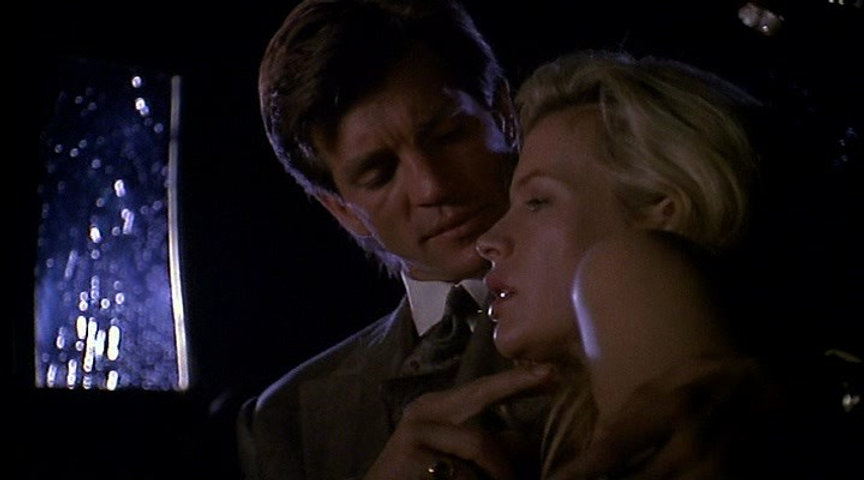 "Eric Roberts and Kim Basinger in 1992's ""Final Analysis."""
