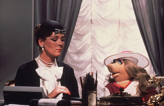 "Diana Rigg and Miss Piggy in 1981's ""The Great Muppet Caper."""