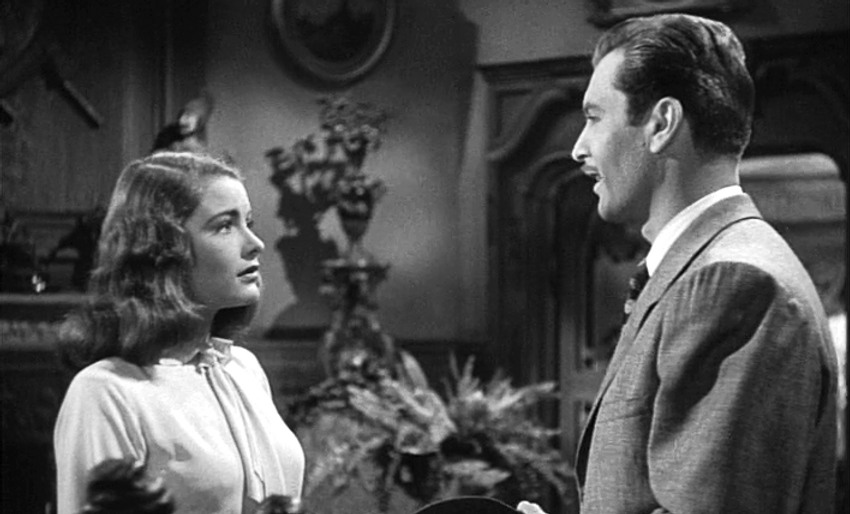 """Nancy Guild and George Montgomery in 1947's """"The Brasher Doubloon."""""""
