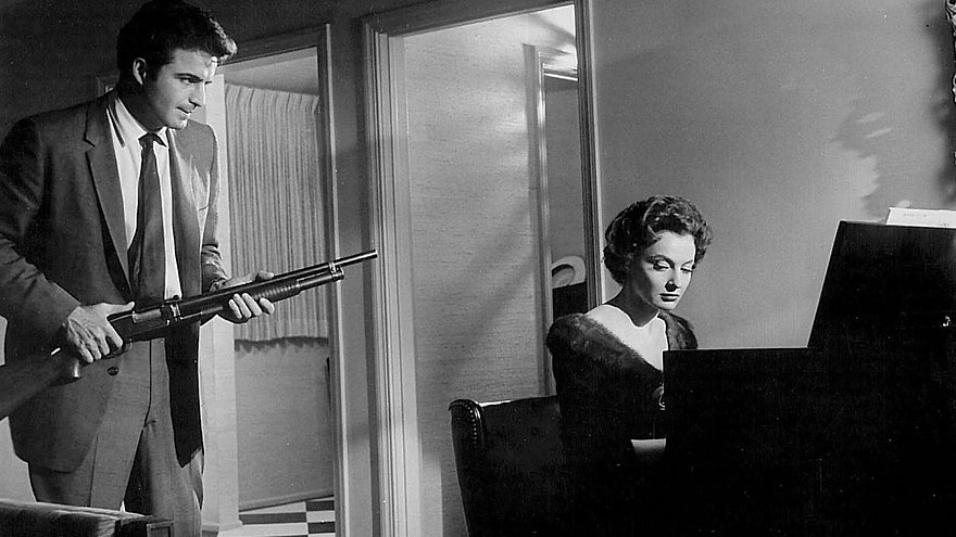 "Vince Edwards and Caprice Torei in 1958's ""Murder by Contract."""