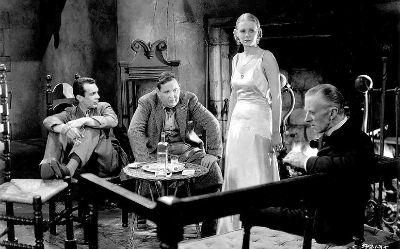 """Raymond Massey, Charles Laughton, Gloria Stuart, and Ernest Thesiger in 1932's """"The Old Dark House."""""""