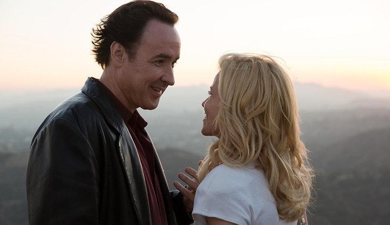 "John Cusack and Elizabeth Banks in 2015's ""Love & Mercy."""