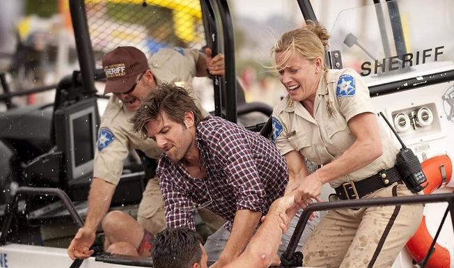 "Adam Scott and Elisabeth Shue in 2010's ""Piranha 3D."""