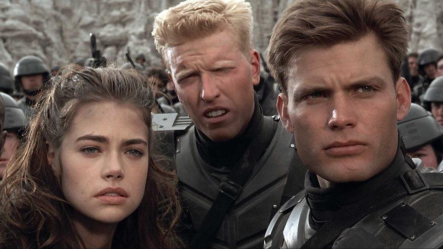 """Denise Richards, Jake Busey, and Casper Van Dien in 1997's """"Starship Troopers."""""""