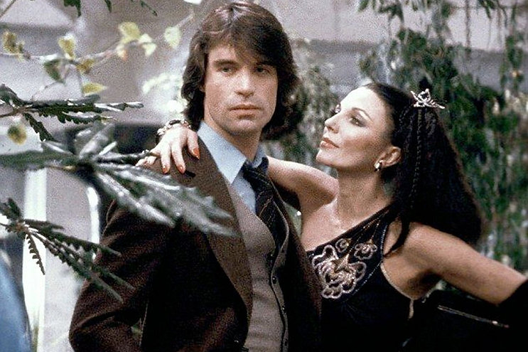 """Oliver Tobias and Joan Collins in 1978's """"The Stud."""""""