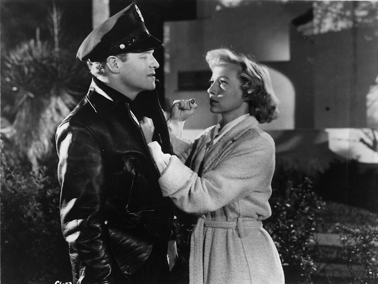 "Van Heflin and Evelyn Keyes in 1951's ""The Prowler."""