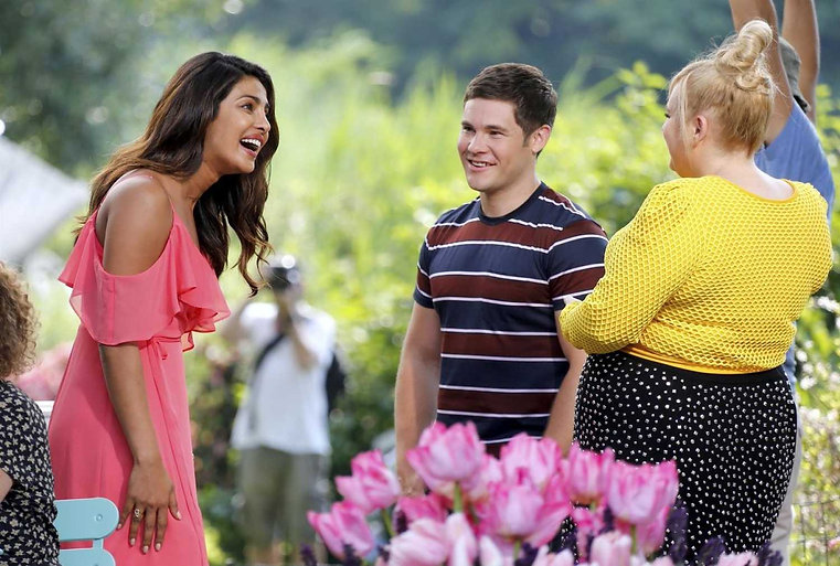 "Priyanka Chopra, Adam Devine, and Rebel Wilson in 2019's ""Isn't It Romantic."""
