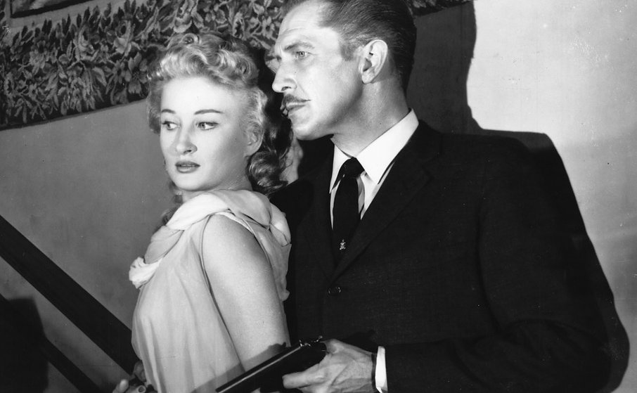 "Carol Ohmart and Vincent Price in 1959's ""House on Haunted Hill."""