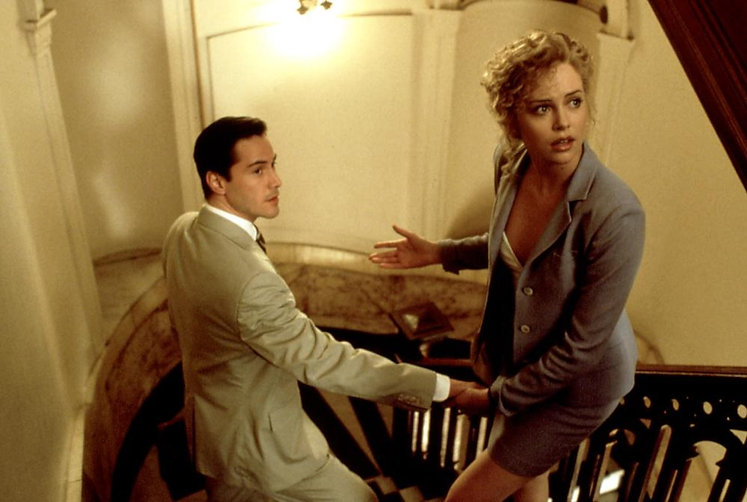 "Keanu Reeves and Charlize Theron in 1997's ""The Devil's Advocate."""