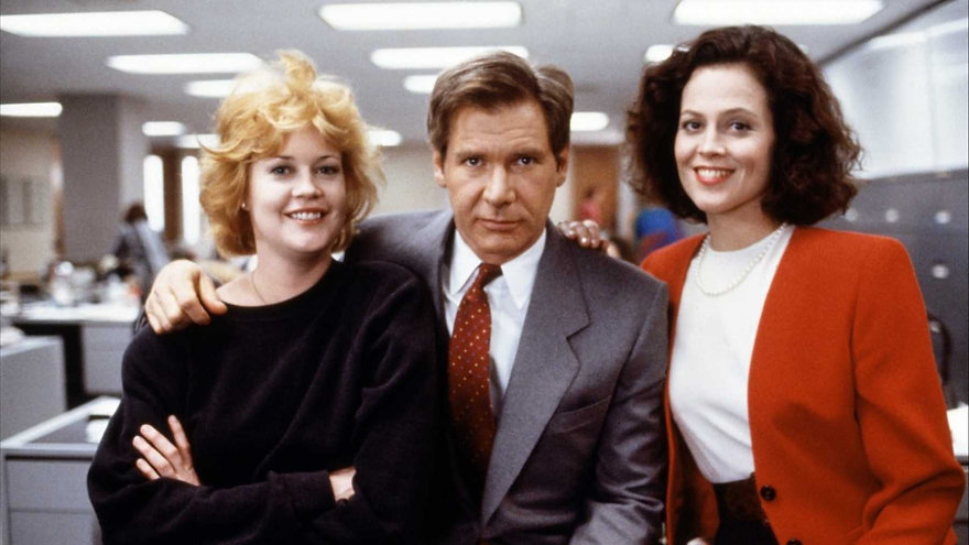 "Melanie Griffith, Harrison Ford, and Sigourney Weaver in 1988's ""Working Girl."""