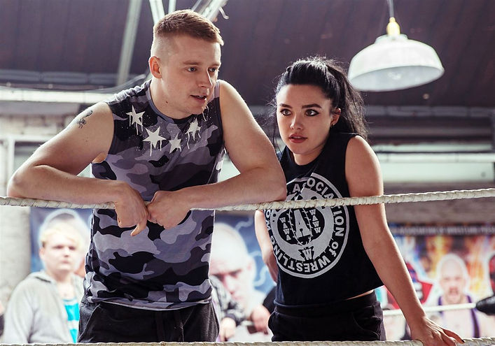 "Jack Lowden and Florence Pugh in 2019's ""Fighting With My Family."""