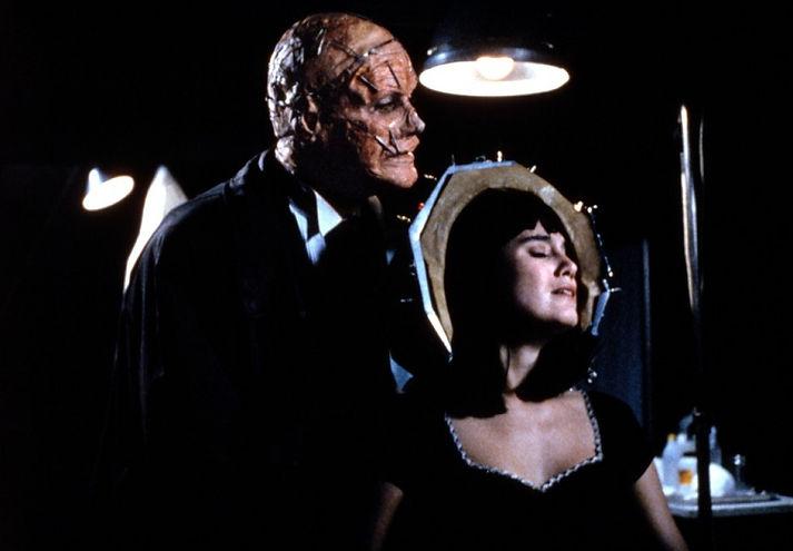 "Tom Villard and Jill Schoelen in 1991's ""Popcorn."""