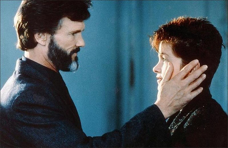 "Kris Kristofferson and Geneviève Bujold in 1985's ""Trouble in Mind."""