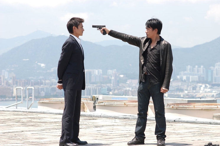 "Andy Lau and Tony Leung in 2002's ""Infernal Affairs."""