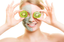 Skin Care. Woman In Clay Mask With Kiwi