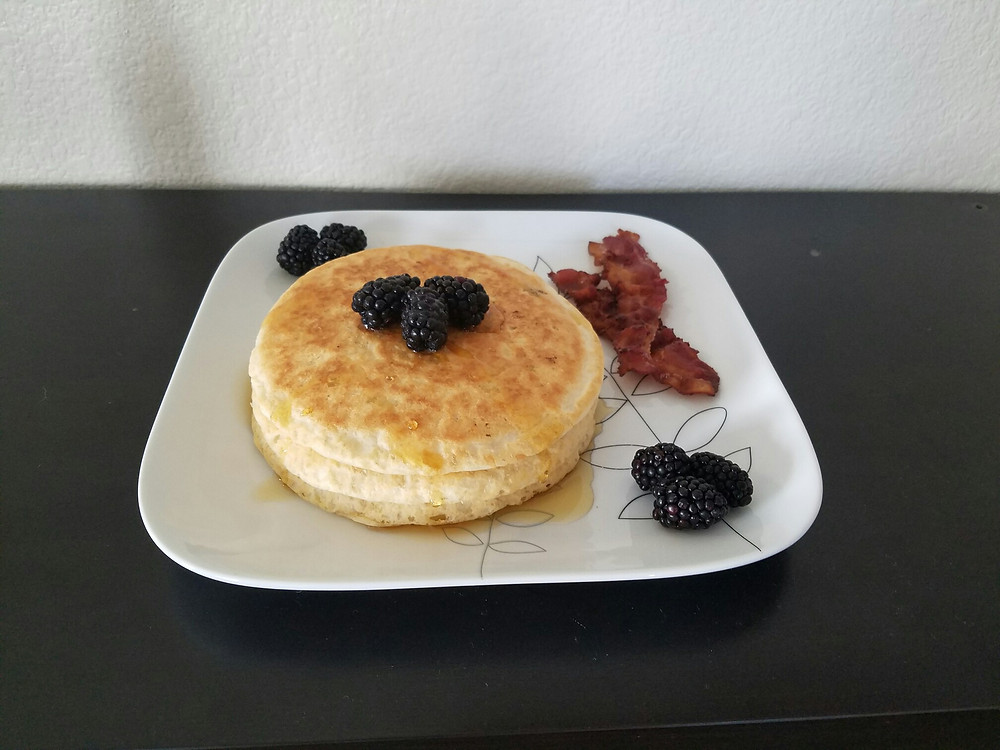 Pancakes with blackberries, bacon, and syrup