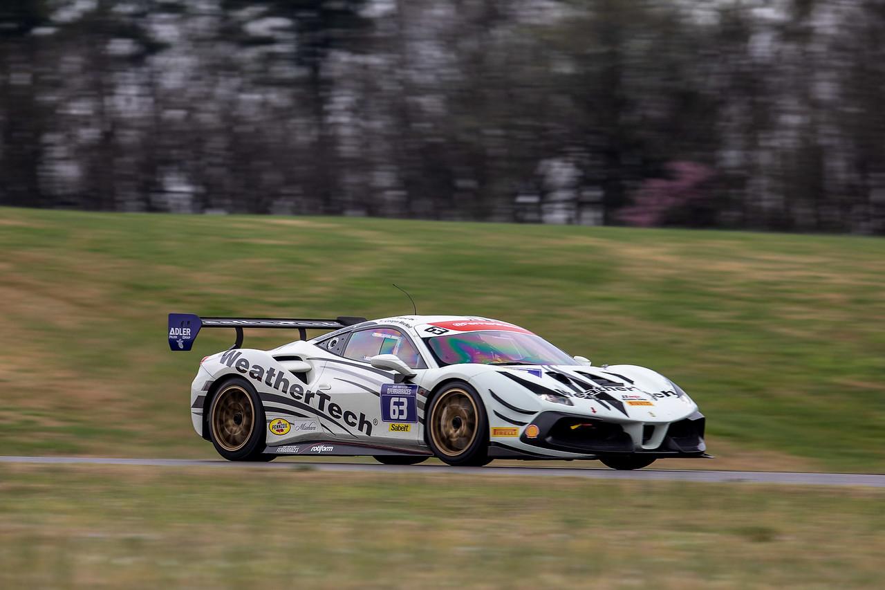 Ferrari racing around the track.