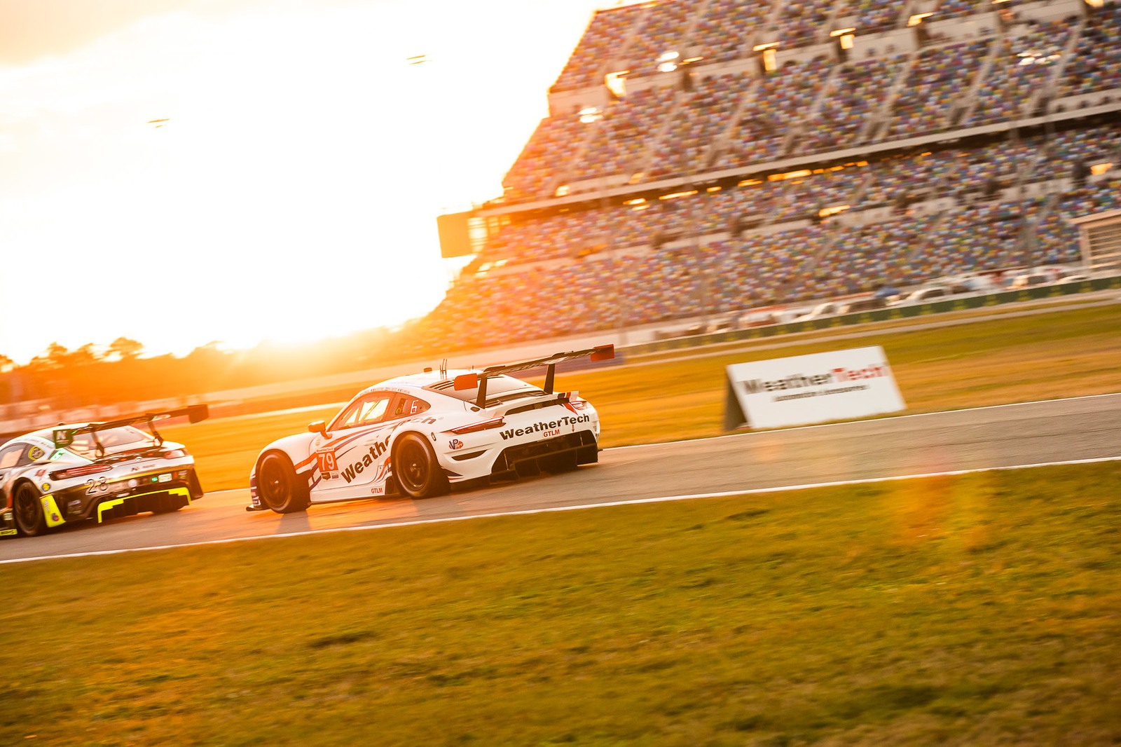 Porsche racing at sunset.