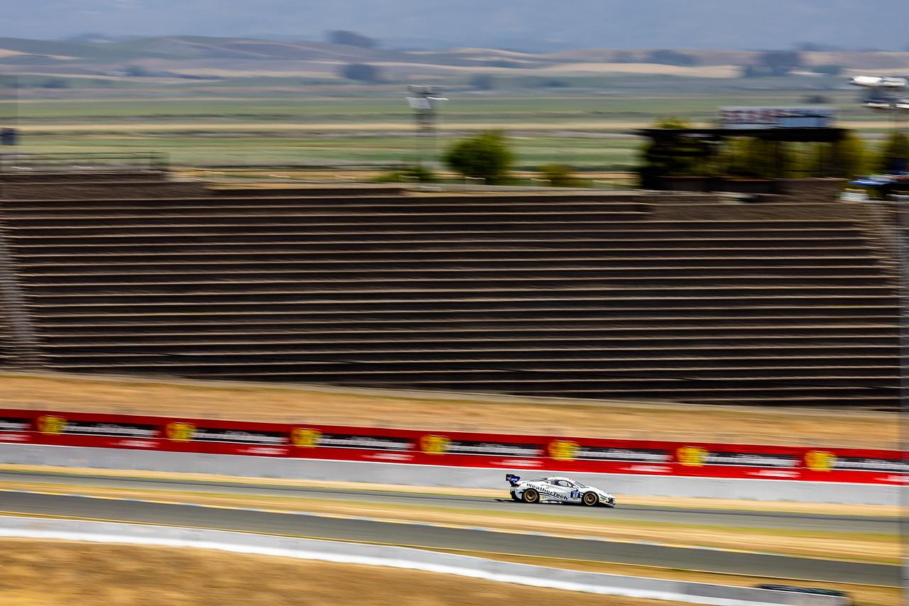 Ferrari speeding on the track.